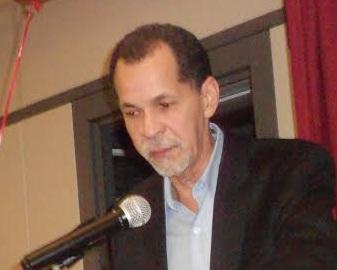 Luis Abinader y el cadáver de Daniel Santos a sus pies
