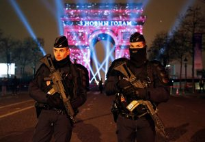 Policemen secure the Champs Elysees Avenue as Revellers gather during New Year celebrations in Paris,France, late December 31, 2016. REUTERS/Jacky Naegelen