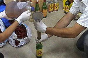 SDE: Detienen miembros de red comercializaba alcohol adulterado
