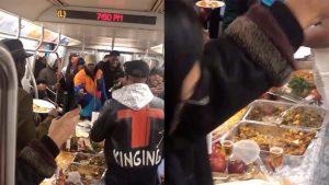 Pasajeros realizan cena Acción de Gracias en el subway de N. York