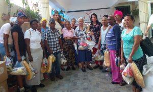 SDO: Damas Solidarias entregan más de 3 mil raciones alimenticias