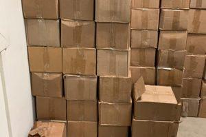 SANTIAGO:  Ocupan miles botellas de ron adulterado en una residencia