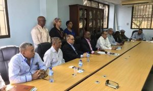 Trabajadores RD conmemoran su día afligidos por la parálisis económica